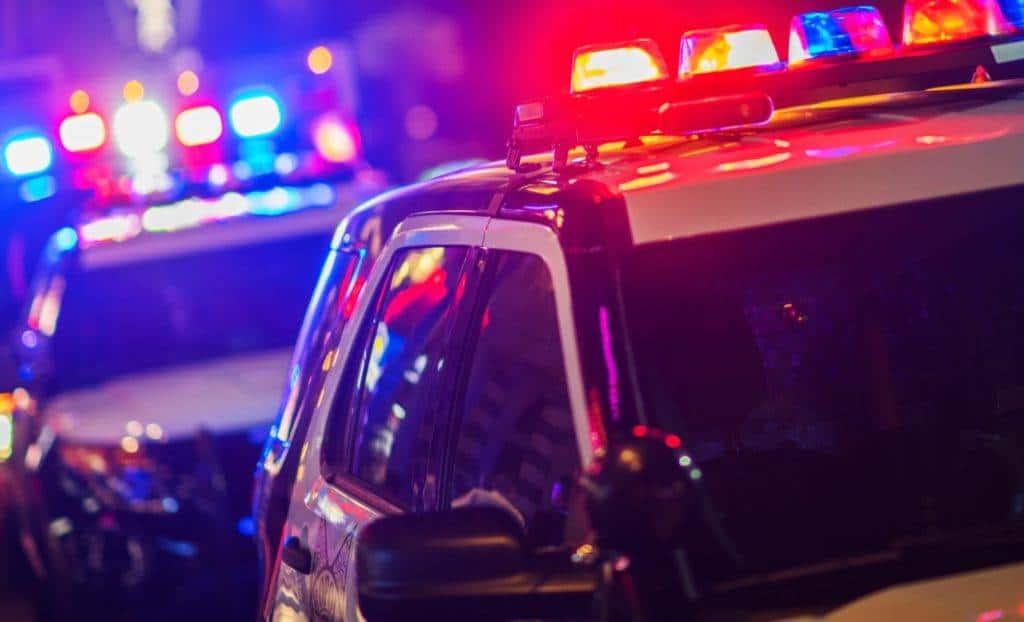Police car stopping individual