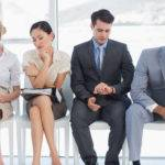 Four business people waiting