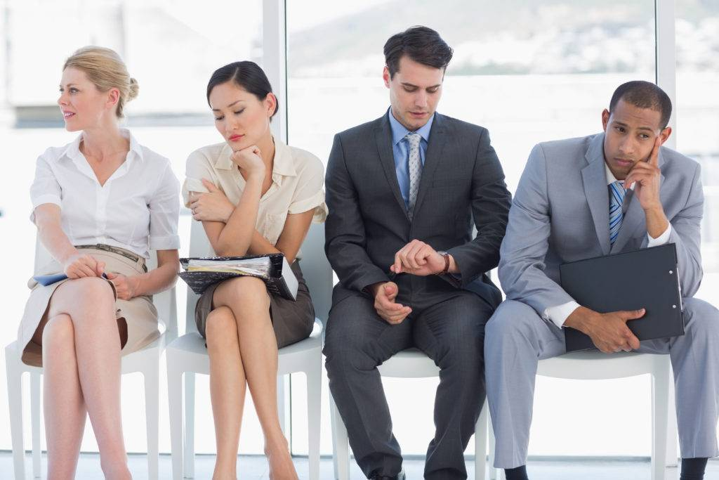 Four business people sat waiting